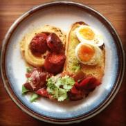 Soft boiled egg, hommus, tomato, chorizo and sourdough bread